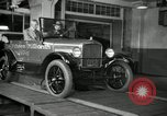 Image of Edsel Ford with Model T Fifteen Millionth car Highland Park Michigan USA, 1927, second 57 stock footage video 65675031963