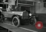 Image of Edsel Ford with Model T Fifteen Millionth car Highland Park Michigan USA, 1927, second 58 stock footage video 65675031963