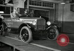 Image of Edsel Ford with Model T Fifteen Millionth car Highland Park Michigan USA, 1927, second 59 stock footage video 65675031963