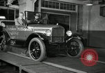 Image of Edsel Ford with Model T Fifteen Millionth car Highland Park Michigan USA, 1927, second 60 stock footage video 65675031963