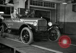 Image of Edsel Ford with Model T Fifteen Millionth car Highland Park Michigan USA, 1927, second 61 stock footage video 65675031963