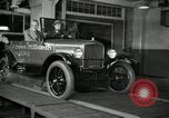 Image of Edsel Ford with Model T Fifteen Millionth car Highland Park Michigan USA, 1927, second 62 stock footage video 65675031963