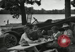 Image of family picnics United States USA, 1922, second 55 stock footage video 65675031972