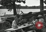 Image of family picnics United States USA, 1922, second 56 stock footage video 65675031972