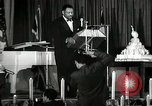 Image of Paul Robeson at his 46th birthday party New York City USA, 1944, second 6 stock footage video 65675032045