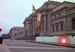 Image of people and buildings New York City USA, 1976, second 34 stock footage video 65675032060