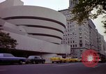 Image of people and buildings New York City USA, 1976, second 42 stock footage video 65675032060