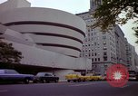 Image of people and buildings New York City USA, 1976, second 43 stock footage video 65675032060
