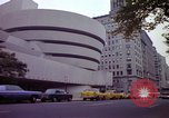 Image of people and buildings New York City USA, 1976, second 44 stock footage video 65675032060