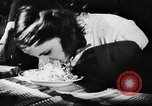 Image of spaghetti eating competition United States USA, 1950, second 5 stock footage video 65675032172