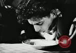 Image of spaghetti eating competition United States USA, 1950, second 11 stock footage video 65675032172