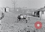 Image of people in rural area United States USA, 1935, second 26 stock footage video 65675032229