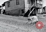 Image of people in rural area United States USA, 1935, second 46 stock footage video 65675032230