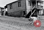Image of people in rural area United States USA, 1935, second 59 stock footage video 65675032230