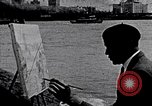 Image of Palmer Hayden painting the Brooklyn bridge New York City USA, 1937, second 1 stock footage video 65675032300