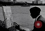 Image of Palmer Hayden painting the Brooklyn bridge New York City USA, 1937, second 2 stock footage video 65675032300