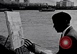 Image of Palmer Hayden painting the Brooklyn bridge New York City USA, 1937, second 3 stock footage video 65675032300