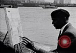 Image of Palmer Hayden painting the Brooklyn bridge New York City USA, 1937, second 6 stock footage video 65675032300