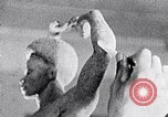 Image of Richmond Barthe sculpture of male and female dancing New York City USA, 1937, second 5 stock footage video 65675032303