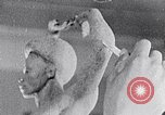 Image of Richmond Barthe sculpture of male and female dancing New York City USA, 1937, second 32 stock footage video 65675032303