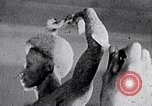 Image of Richmond Barthe sculpture of male and female dancing New York City USA, 1937, second 51 stock footage video 65675032303