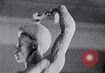 Image of Richmond Barthe sculpture of male and female dancing New York City USA, 1937, second 52 stock footage video 65675032303