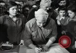 Image of Bulgarian citizens signing letter of appreciation Sofia Bulgaria, 1947, second 58 stock footage video 65675032349