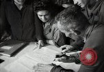 Image of Bulgarian citizens signing letter of appreciation Sofia Bulgaria, 1947, second 59 stock footage video 65675032349