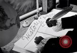 Image of large volume titled history on desk United States USA, 1951, second 38 stock footage video 65675032397