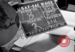 Image of large volume titled history on desk United States USA, 1951, second 45 stock footage video 65675032397