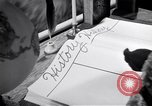 Image of large volume titled history on desk United States USA, 1951, second 46 stock footage video 65675032397