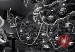 Image of decorated christmas tree and young girl with doll United States USA, 1951, second 5 stock footage video 65675032403