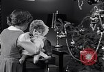 Image of decorated christmas tree and young girl with doll United States USA, 1951, second 7 stock footage video 65675032403