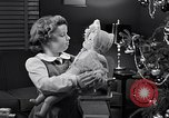 Image of decorated christmas tree and young girl with doll United States USA, 1951, second 13 stock footage video 65675032403