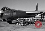 Image of pre-flight inspection of Convair B-36 and crew Fort Worth Texas USA, 1951, second 3 stock footage video 65675032420