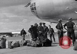 Image of Unloading materiel from a B-36 Roswell New Mexico USA, 1953, second 19 stock footage video 65675032428