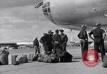 Image of Unloading materiel from a B-36 Roswell New Mexico USA, 1953, second 20 stock footage video 65675032428