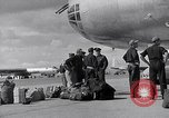 Image of Unloading materiel from a B-36 Roswell New Mexico USA, 1953, second 21 stock footage video 65675032428