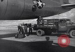 Image of Unloading materiel from a B-36 Roswell New Mexico USA, 1953, second 28 stock footage video 65675032428