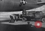 Image of Unloading materiel from a B-36 Roswell New Mexico USA, 1953, second 29 stock footage video 65675032428