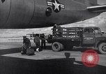 Image of Unloading materiel from a B-36 Roswell New Mexico USA, 1953, second 30 stock footage video 65675032428