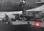 Image of Unloading materiel from a B-36 Roswell New Mexico USA, 1953, second 32 stock footage video 65675032428