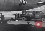 Image of Unloading materiel from a B-36 Roswell New Mexico USA, 1953, second 33 stock footage video 65675032428
