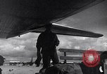 Image of Unloading materiel from a B-36 Roswell New Mexico USA, 1953, second 36 stock footage video 65675032428