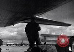 Image of Unloading materiel from a B-36 Roswell New Mexico USA, 1953, second 37 stock footage video 65675032428