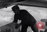 Image of Unloading materiel from a B-36 Roswell New Mexico USA, 1953, second 42 stock footage video 65675032428