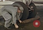 Image of Fire guard for aircraft engine start Honolulu Hawaii USA, 1959, second 19 stock footage video 65675032481