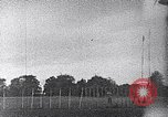 Image of A man is lofted into the air by an airplane Thomasville Georgia United States USA, 1935, second 43 stock footage video 65675032574