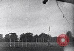 Image of A man is lofted into the air by an airplane Thomasville Georgia United States USA, 1935, second 47 stock footage video 65675032574