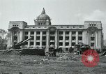 Image of 155mm howitzers next to capitol building Seoul South Korea, 1951, second 7 stock footage video 65675032641